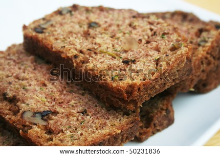 Close up of slices of zucchini bread on a white plate - stock photo