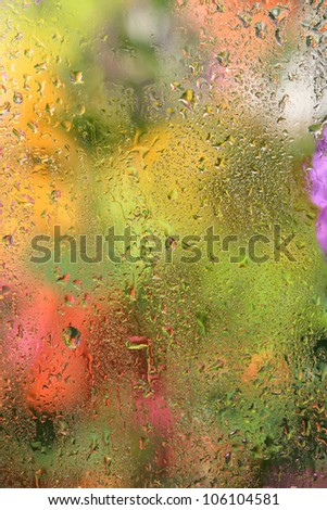 Close-up of small drops on rainy window. Abstract autumn background. - stock photo