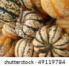 Close up of small funky colored organic pumpkins at a farmers market in San Francisco. - stock photo