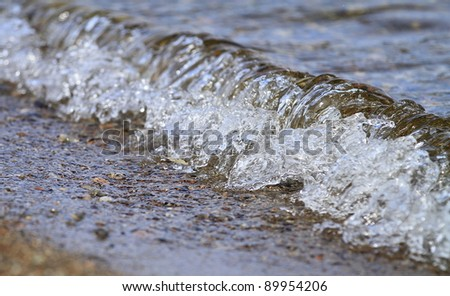 Close up of small wave lapping at Loch Ness Scotland - stock photo