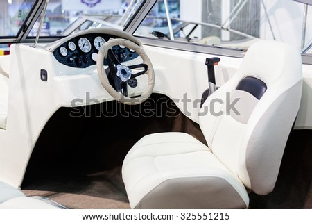 close up of small white speedboat at nautical exhibition - stock photo