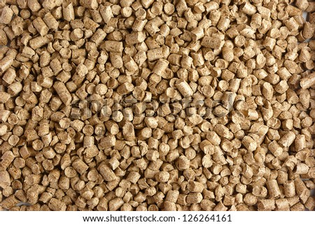 Close-up of small wood pellets - stock photo