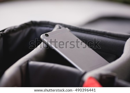 Close up of smartphone in grey pocket. Modern model of popular gadget. Macro, copy space.