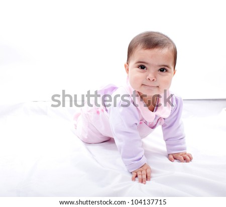 Close up of smiling baby crawling on floor - stock photo