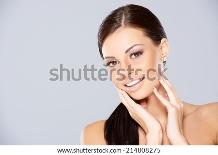 Close up of Smiling beautiful woman with black long hair - stock photo