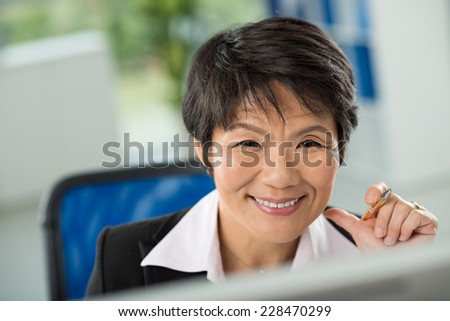 Close-up of smiling face of businesswoman - stock photo