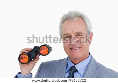 Close up of smiling mature tradesman with spy glass against a white background - stock photo
