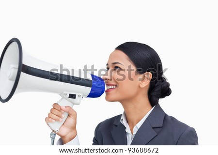 Close up of smiling saleswoman with megaphone against a white background