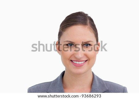 Close up of smiling tradeswoman against a white background