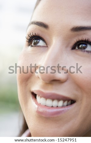 Close up of smiling woman smiling off camera - stock photo