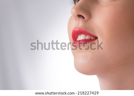 Close-up of smiling woman with red lipstick on - stock photo