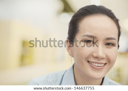Close-up of smiling young woman, portrait