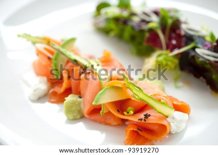 Close up of smoked salmon salad with green asparagus and avocado - stock photo