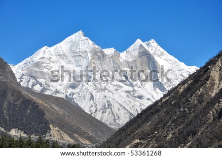 close up of snow clad mountain with three peaks