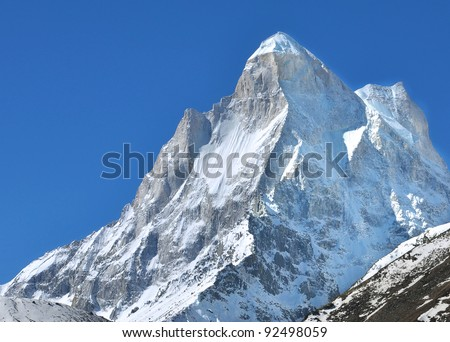 close up of snow clad peak of Mountain shivling