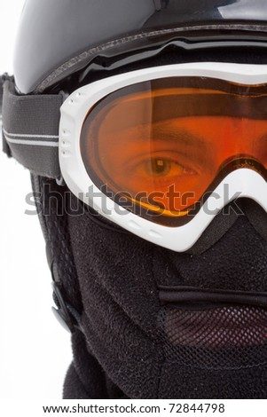 Close-up of snowboarder in balaclava looking through glassess - stock photo