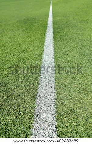 Close up of soccer field with single line  - stock photo