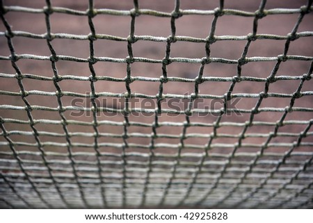 Close up of soccer net with diminishing perspective - stock photo