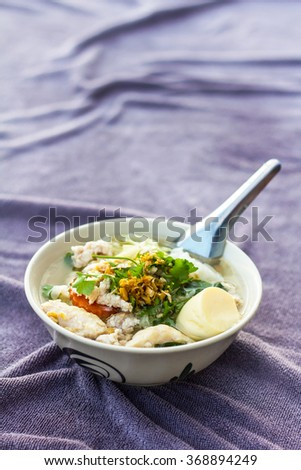 Close up of soft boiled tofu with minced pork meatballs and place on a towel delicious purple. - stock photo