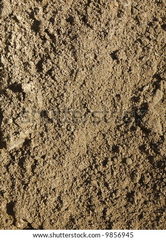 Close up of soil dug up from a garden. - stock photo