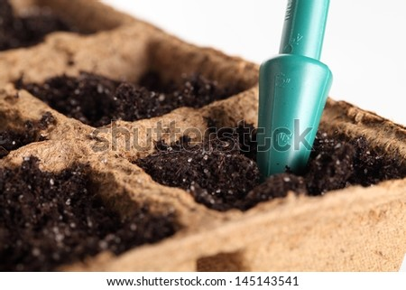 Close-up of soil in planting pots