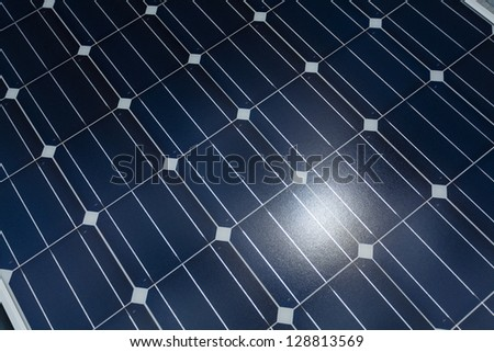 Close up of solar panel with sun flare
