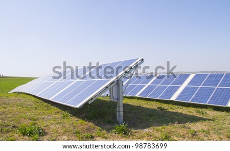 Close up of solar panels under the sun - stock photo