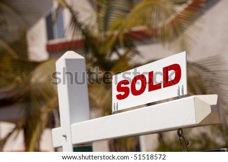 Close-up of Sold Real Estate Sign in Front of House. - stock photo
