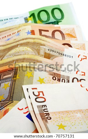 close up of some 50 and 100 euro bills - stock photo