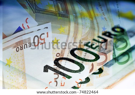 close up of some 100 and 50 euro bills - stock photo