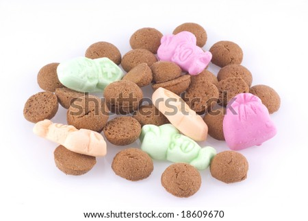 Close up of some candy eaten in Holland during a dutch holiday called sinterklaas; isolated on white. - stock photo