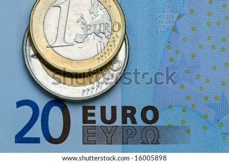 Close-up of some euros - banknote and coins. - stock photo
