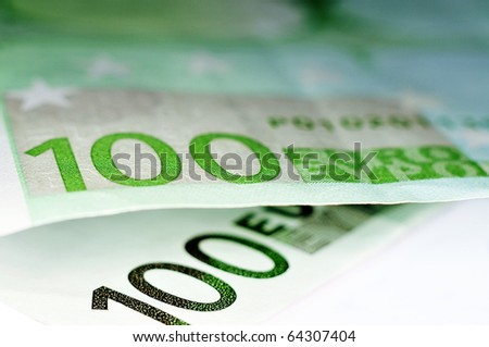close up of some 100 euros bills - stock photo