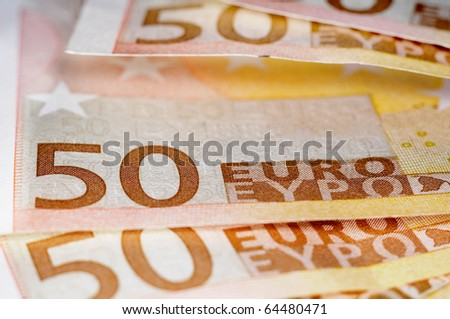 close up of some 50 euros bills - stock photo