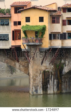 close up of some of the buildings hanging off the Ponte Vecchio in Florence - stock photo