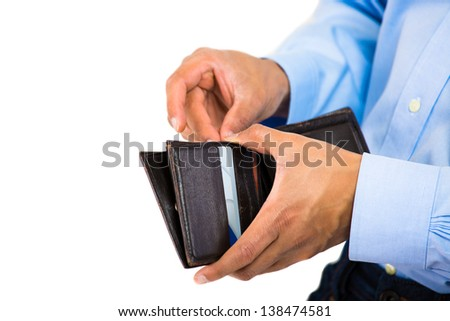 Close up of someone holding a wallet and taking out money  - stock photo