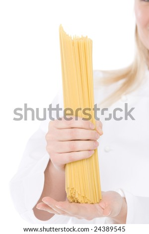 close up of spaghetti in hand o a chef - stock photo