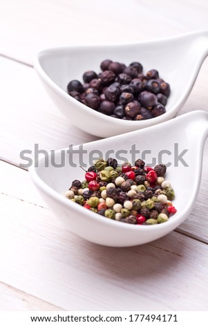 Close up of spices and rosemary ,juniper berries, pepper