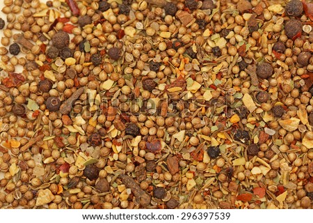 Close up of spices mix Garam Masala: garlic, sea salt, chili pepper, cloves, Bay leaf, ginger, celery, mustard, sesame, cardamon, cinnamon bark, black pepper corns,  cumin, grated nutmeg, coriander - stock photo