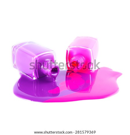 Close up of Spilled colorful nail polish  - stock photo