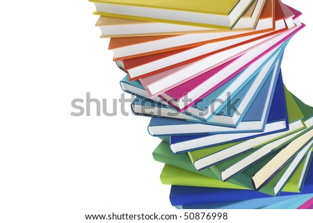 Close-up of spiral stack of colorful real books, tilted. - stock photo