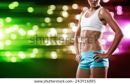 Close up of sport woman in shorts and top - stock photo