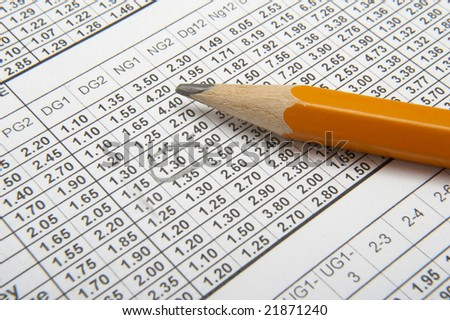 close up of sports betting slip and pencil - stock photo