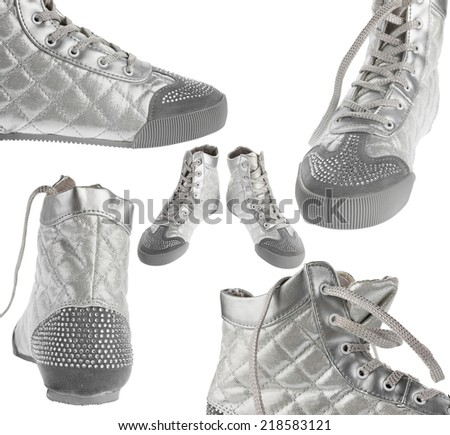 Close-up of sports silver sneakers, isolated on white background