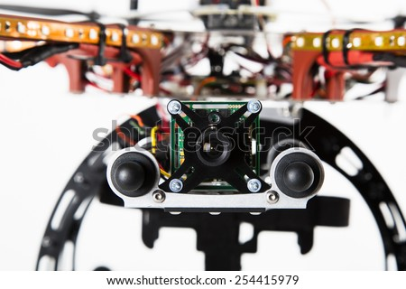 Close up of spy camera attached to drone - stock photo