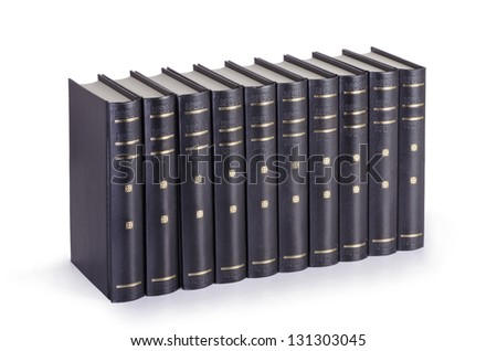 Close up of stack of black books on white background. - stock photo