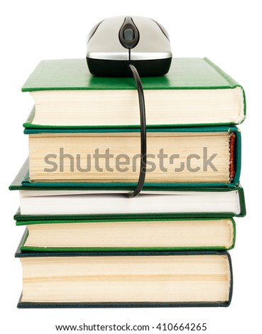 Close up of stack of books and computer mouse on white background - stock photo