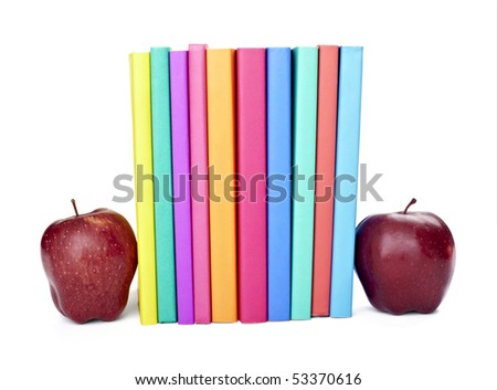 close up of stack of colorful books and apples on white background, with clipping path included - stock photo
