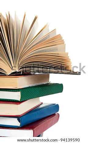 close up of stack of colorful books isolated on white background - stock photo