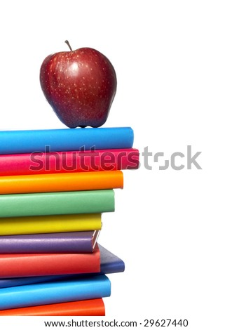 close up of stack of colorful books with apple on white background, with clipping path included - stock photo